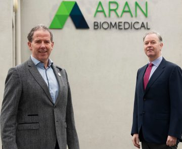 Two men outside of the Aran Biomedical facility in An Spidéal in Galway